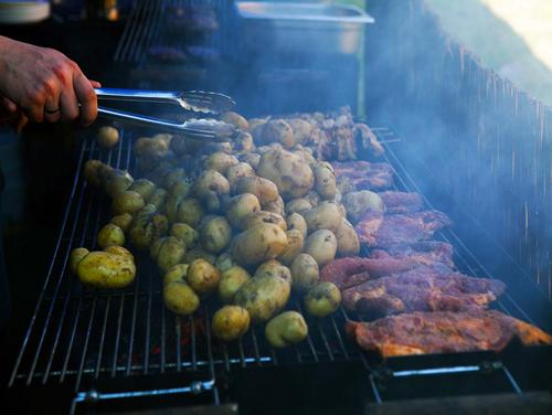 grilled meals, corporate event, campfire